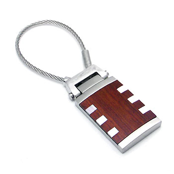 """Although a key ring is not the first thing that people see in a person, it will certainly give an extra added value on people's opinion about your lifestyle, especially if you are a business professional. This key ring has a smart design using stainless steel and abalone shell wood which seems very exclusive."""